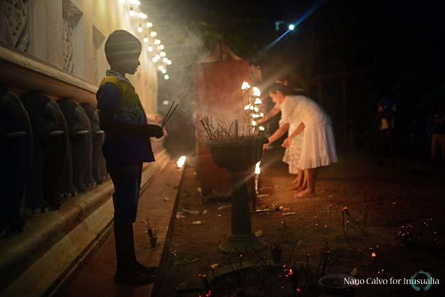 People light candles and incense as offerings and prayers at UNESCO World Heritage, Galle Fort, during Binara Full Moon Poya Day.