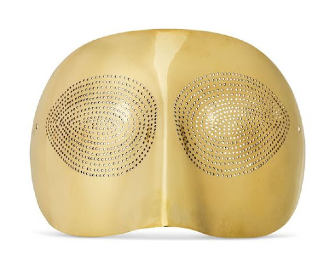 Gold plated silver mask by Man Ray with a group of tiny perforations
