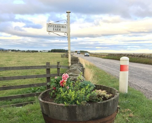 The sign at the top of the farm road