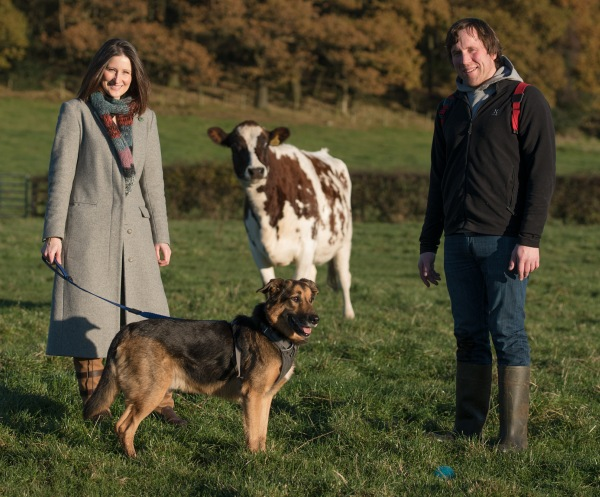 B&B and farm owners Sarah and Gavin with the cows and Max the dog