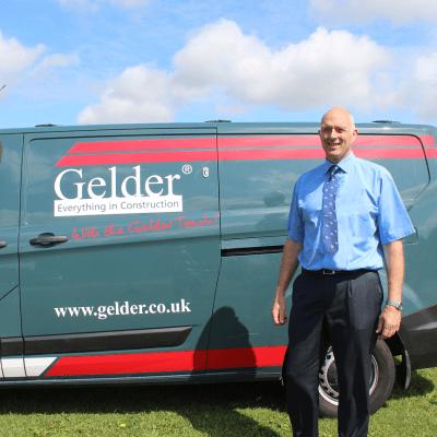 Steve Gelder standing in front of a 'Gelder' van