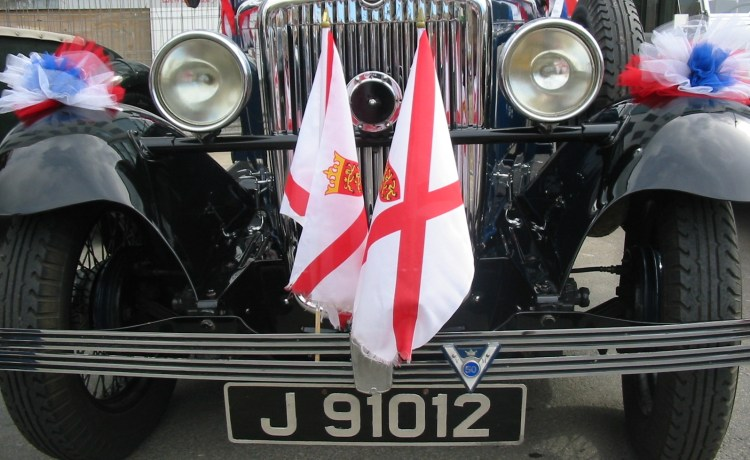 Vintage car on display in Jersey for Liberation Day 9th May 2006 decorated with Jersey flags - Offshore savings plan