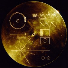 "Voyager Golden Record This gold aluminium cover was designed to protect the Voyager 1 and 2 ""Sounds of Earth"" gold-plated records from micrometeorite bombardment, but also serves a double purpose in providing the finder a key to playing the record. The explanatory diagram appears on both the inner and outer surfaces of the cover, as the outer diagram will be eroded in time. Flying aboard Voyagers 1 and 2 are identical ""golden"" records, carrying the story of Earth far into deep space. The 12 inch gold-plated copper discs contain greetings in 60 languages, samples of music from different cultures and eras, and natural and man-made sounds from Earth. They also contain electronic information that an advanced technological civilization could convert into diagrams and photographs. Currently, both Voyager probes are sailing adrift in the black sea of interplanetary space, flying towards the outmost border of our solar system - Bitcoin"