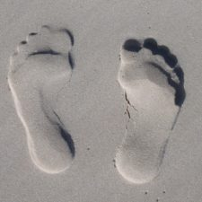 footprints on sand on the path to retirement
