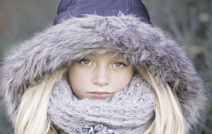 Protect Your Assets portrait of beautiful girl in warm clothing
