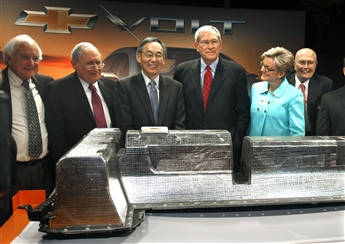 Standing behind the first lithium-ion battery off the Brownstown, Mich., assembly line of the Chevrolet Volt in January were, from left, Rep. Sander...