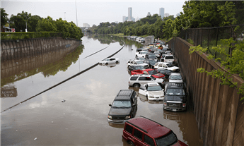 Floods strand motorists after heavy rain in Houston on Tuesday. AP