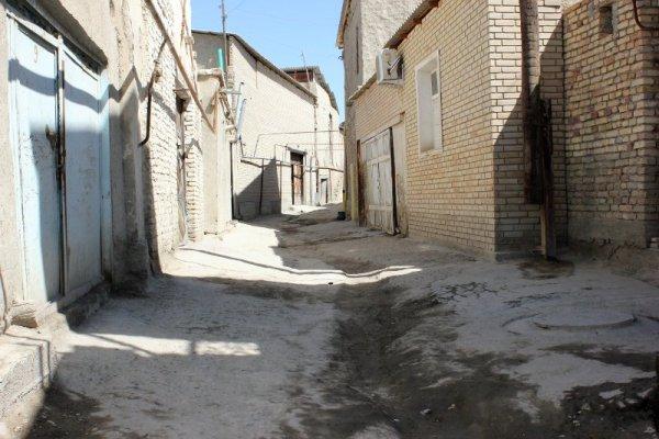Vicolo terra battuta Bukhara Uzbekistan
