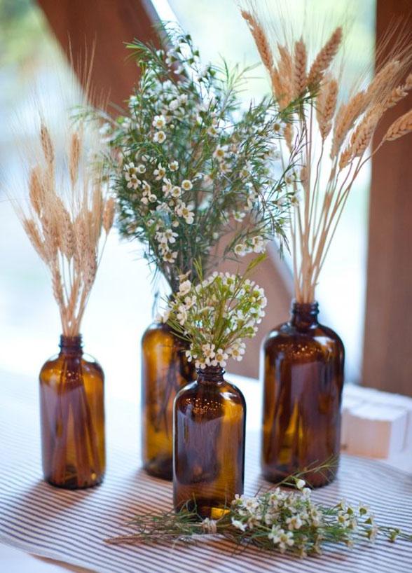 fall wedding decor brown glass bottles centerpiece wheat wildflowers flowers