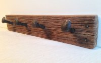 Keruing wood rustic coat rack with railway spike hangers