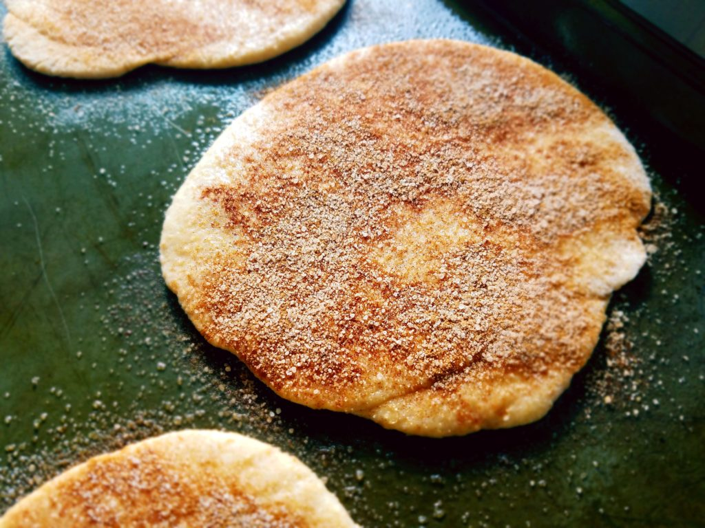 Cinnamon sugar whole wheat pitas that are ready to be baked to fluffy perfection.