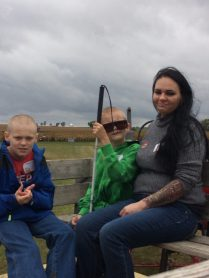 Mother and two sons on the hayride.