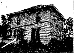 White arrow points to window through which Cook was shot (Davenport Democrat & Leader)