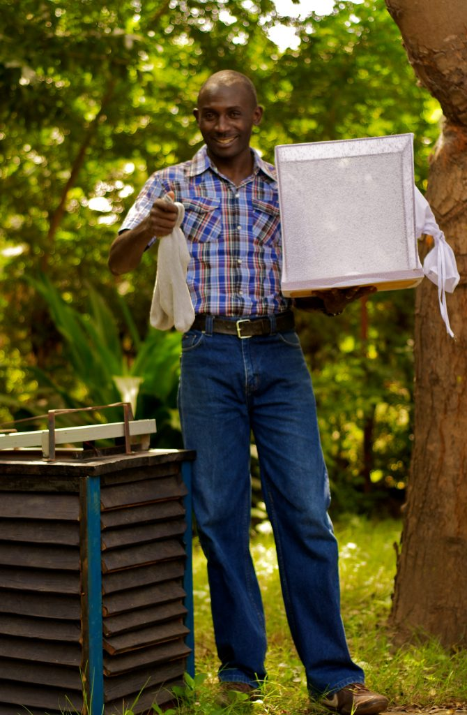 Kenyan innovator displaying an easy to use indoor mosquito trap, presented during the Grand Challenges Africa conference in February this year. Photo courtesy: Africa Academy of Sciences