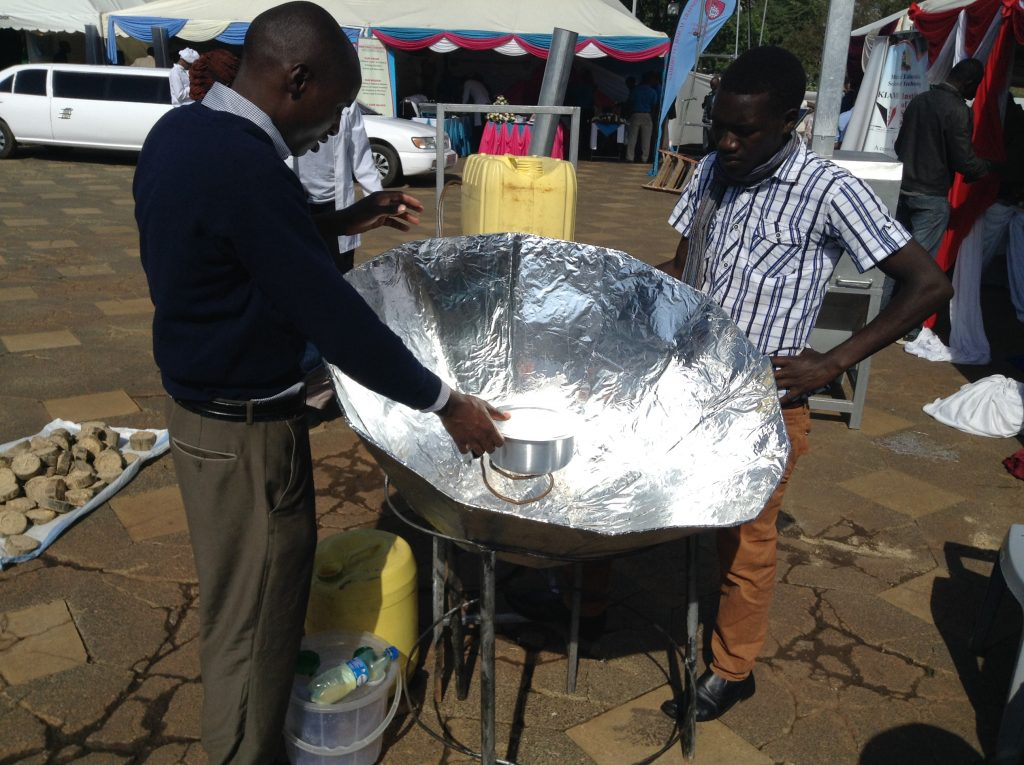 Josephat Ngetich and Cosmas Mibei, students of Friends College Kaimosi, Western Kenya, showcasing how a multi solar cooker they have designed works during the National Science week organised by the National Commission for Science, Technology and Innovation (NACOSTI) and held in Nairobi, Kenya in May 2016