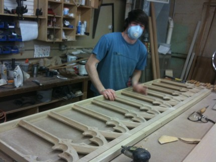Sanding sections of the altar rail before staining.