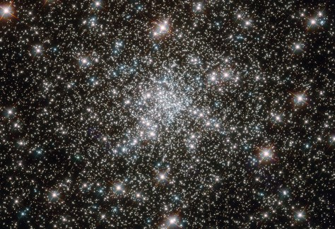 """NASA image release February 8, 2012 Looking like a hoard of gems fit for an emperor's collection, this deep sky object called NGC 6752 is in fact far more worthy of admiration. It is a globular cluster, and at over 10 billion years old is one the most ancient collections of stars known. It has been blazing for well over twice as long as our solar system has existed. NGC 6752 contains a high number of """"blue straggler'' stars, some of which are visible in this image. These stars display characteristics of stars younger than their neighbors, despite models suggesting that most of the stars within globular clusters should have formed at approximately the same time. Their origin is therefore something of a mystery. Studies of NGC 6752 may shed light on this situation. It appears that a very high number -- up to 38 percent -- of the stars within its core region are binary systems. Collisions between stars in this turbulent area could produce the blue stragglers that are so prevalent. Lying 13,000 light-years distant, NGC 6752 is far beyond our reach, yet the clarity of Hubble's images brings it tantalizingly close. Credit: ESA/Hubble & NASA"""
