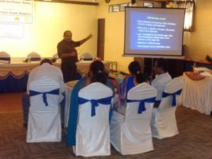 Dr. Purushottam, the Tumkur district surveillance officer addressing the participants.