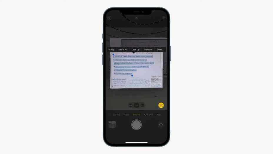 An iPhone Camera pointed at a whiteboard showing Copy/Paste options for text