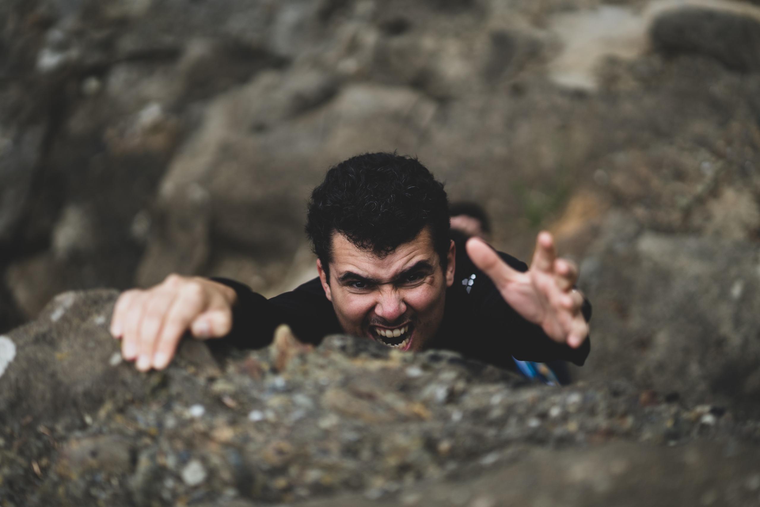 Man on mountain climbing pristine