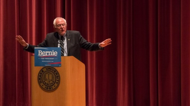 Bernie Sanders stands at campaign podium