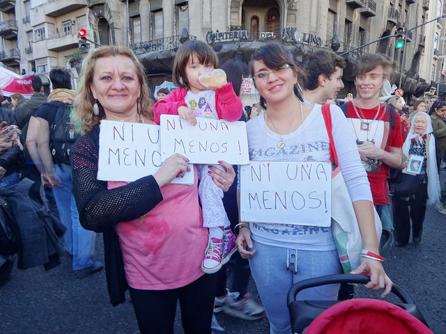 "Soraima Torres, her daughter Mariela and her granddaughter, three generations of Argentine women, hold up signs with the slogan ""Ni Una Menos"", in the demonstration against femicide in Buenos Aires. Credit: Fabiana Frayssinet/IPS"