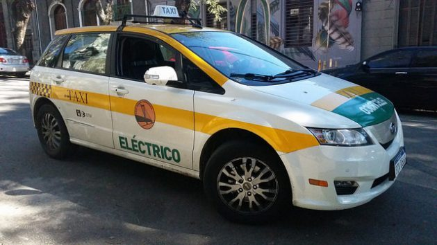 Alejandro Casas's electric taxi, which he drives in Montevideo, cost him 63,000 dollars, but he was given a five-year loan and he gets free recharges, as part of an initiative supported by the state-owned electric company and the government of the Uruguayan capital. Credit: Verónica Firme/IPS