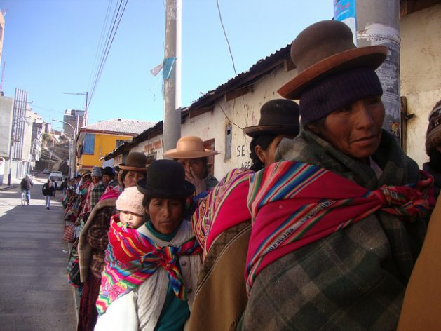 Poor women from the Andes highlands queuing up for aid in a village in Peru's Puno region. Credit: Milagros Salazar/IPS