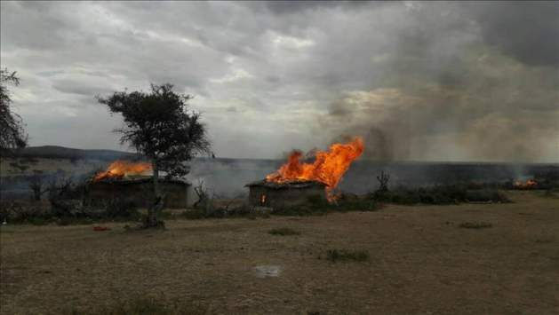 A plume of smoke billowing from a burnt hut in Loliondo, Tanzania on16 August 2017. Photo: courtesy of IWGIA.