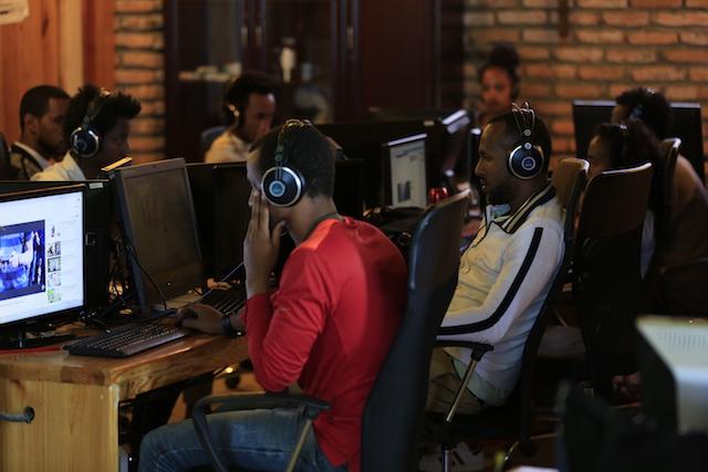 Staff working at KANA TV, and filming of original productions. Photo courtesy KANA TV.
