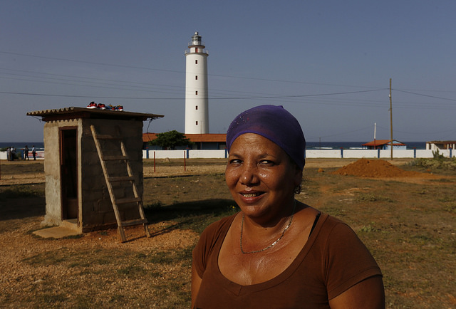Sports coach Milaydis Griñán lives near the historic Punta de Maisí lighthouse on the eastern tip of the Cuban island. Members of three families have worked as lighthouse keepers for generations. Credit: Jorge Luis Baños/IPS
