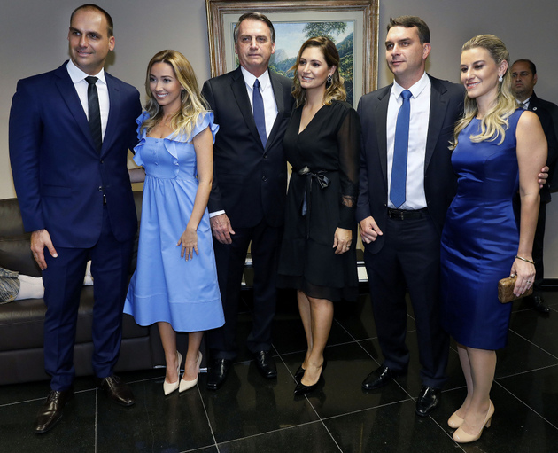 Jair Bolsonaro receives the document officially naming him president-elect of Brazil, next to his wife, two of his five children - one of whom is a member of the lower house and the other a senator - and their wives. A staunch defender of the traditional family, his will have a strong presence in his government, which has already begun to spark conflicts and scandals involving some of his offspring. Credit: Roberto Jayme/Ascom/TSE-Fotos Públicas
