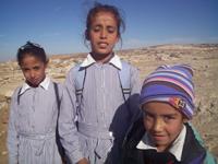 Children waiting for an Israeli military escort near At Tuwani. / Credit:Mel Frykberg/IPS