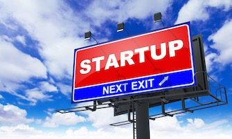 Startup - Red Billboard on Sky Background. Business Concept.