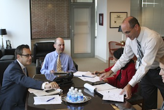 Hirshfeld (standing right) has been a member of USPTO senior management since 2009.