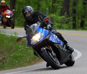 """Warren riding a BMW K1300S, 175 horsepower sport bike at the famous """"Tail of the Dragon"""" run in North Carolina."""