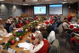 """NORAD Tracks Santa Operations Center 2007"" by NORAD Public Affairs, Sgt. 1st Class Gail Braym. Public domain."