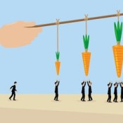 A large hand holds a carrots on a stick. a metaphor on management, incentive and leadership.