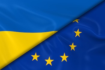Flags of ukraine and the european union divided diagonally