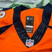 """Counterfeit NFL Jerseys Seized by CBP at JFK International Mail Facility"" by Josh Denmark/U.S. Customs & Border Patrol. Public domain."
