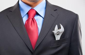 businessman wrench