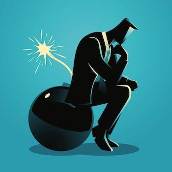 Businessman thinking sitting on a bomb