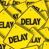 delay - https://depositphotos.com/129543946/stock-photo-yellow-road-signs.html