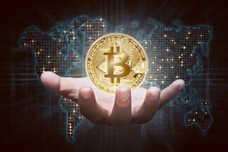 bitcoin - https://depositphotos.com/180949828/stock-photo-male-hand-showing-golden-bitcoin.html