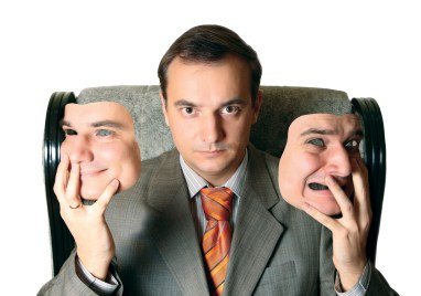 https://depositphotos.com/11502618/stock-photo-man-holding-his-face-masks.html