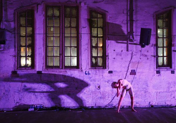 """Performer of Maltese artists' collective 'rubberbodies' takes part in dress rehearsal of """"100"""" in Cospicua in Valletta's Grand Harbour"""