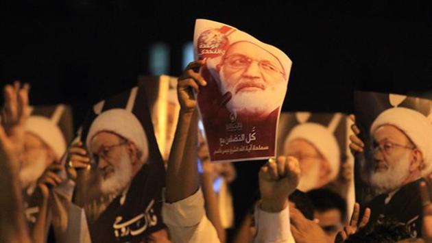 Bahraini demonstrators attend a protest against the revocation of the citizenship of top Shia cleric, Sheikh Isa Qassim,  near Qassim's house in the village of Diraz, west of Manama.