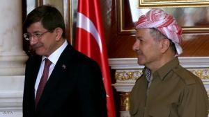 Iraqi Kurdish leader Massud Barzani (R) walks alongside Turkish Prime Minister Ahmet Davutoglu during their meeting in Arbil, the capital of the Kurdish autonomous region in northern Iraq, on November 21, 2014. Davutoglu's trip to Iraq follows a visit to Turkey by Iraqi Foreign Minister Ibrahim al-Jaafari earlier this month that was aimed at patching up the chilly ties between the two neighbours. AFP PHOTO / SAFIN HAMED        (Photo credit should read SAFIN HAMED/AFP/Getty Images)