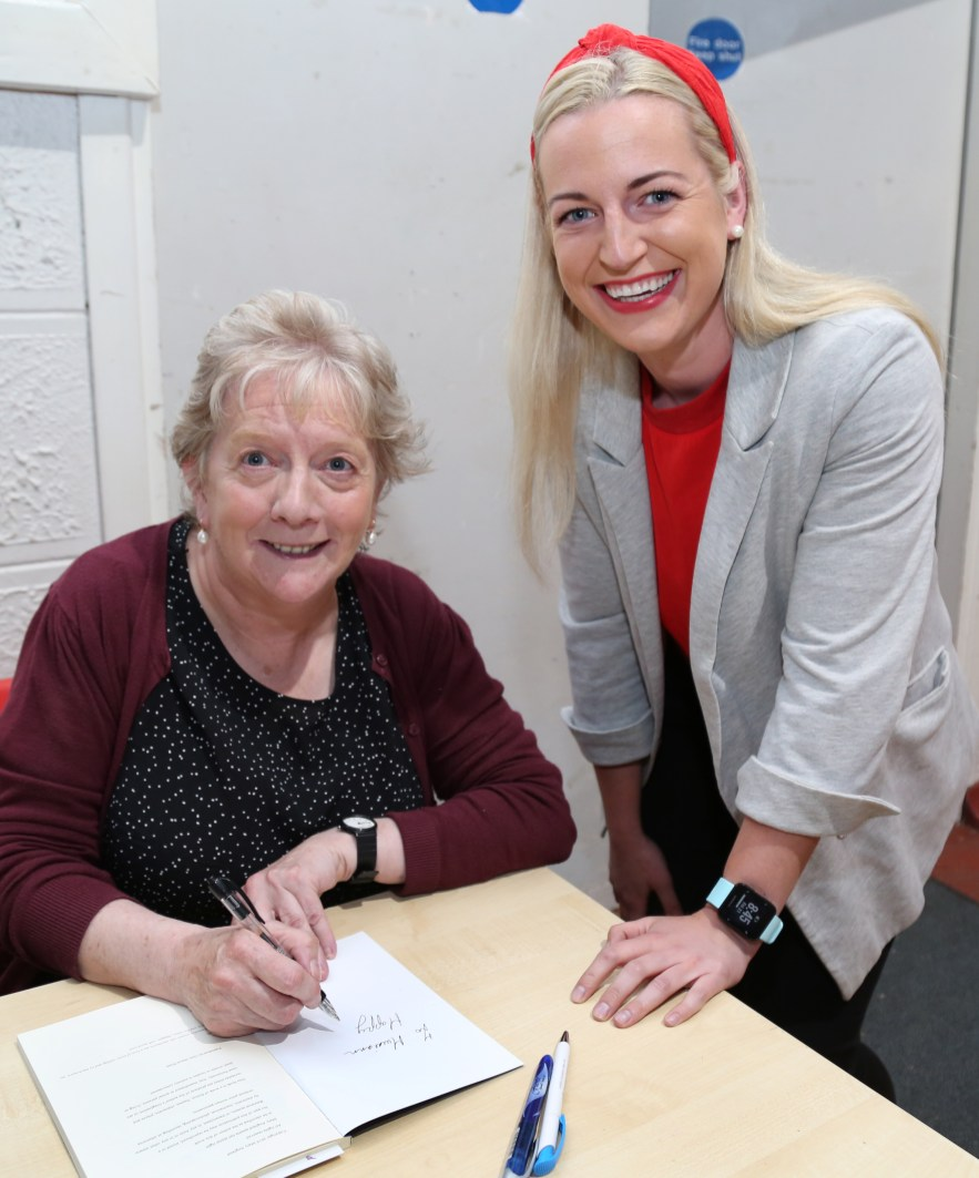 Mary Angland signing a copy of her Book for Muireann Stack