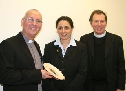 Archdeacon Stephen McBride and Canon John Mann present a Connor plate to Deputy Israeli Ambassador to Ireland, Ms Ruth Zack